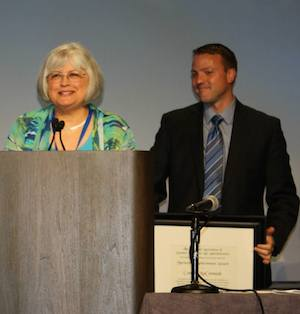 Connie McCormack receives Meritorious Achievement Award
