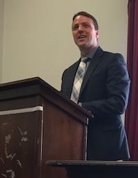 NASFAA President and CEO Justin Draeger delivers a speech
